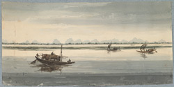 Country boats on the wide expanse of the Ganges with a distant view of the Himalayas
